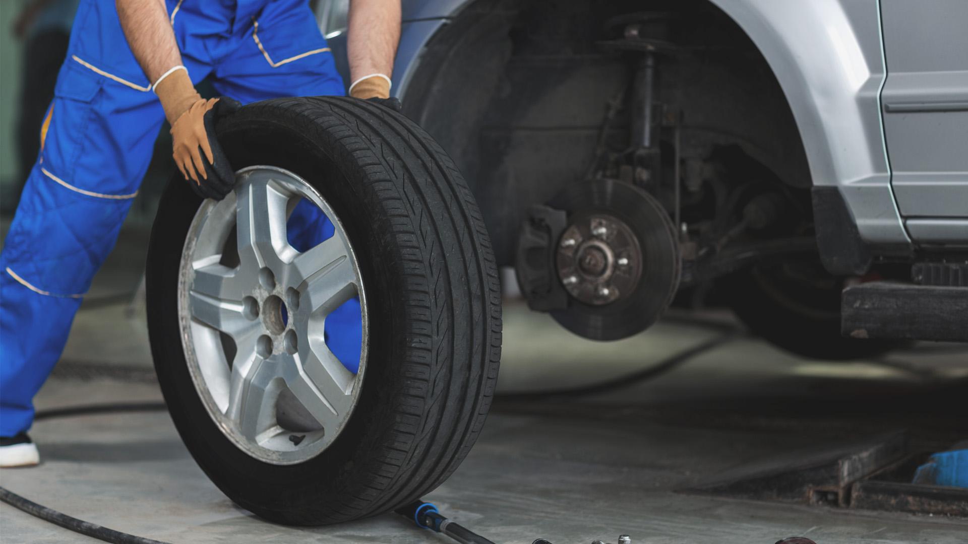 Mechanic replacing car tires